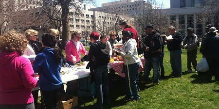 Volunteers offering a lunch in for homeless people in Denver.